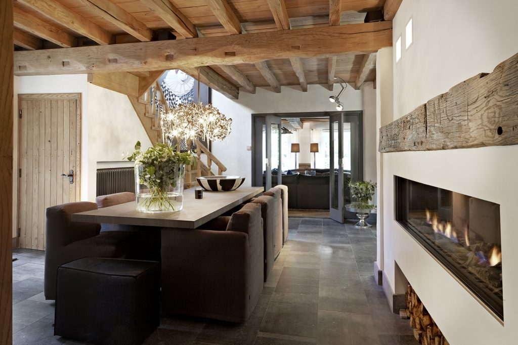 rustic dining room with designer fireplace