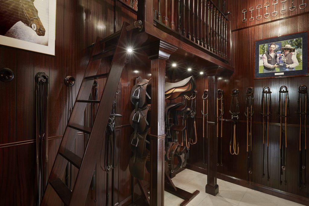 Tack room in glossy mahogany