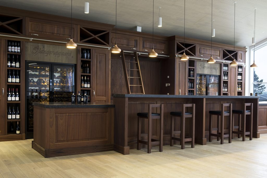 Luxury interior with wine counter in mahogany