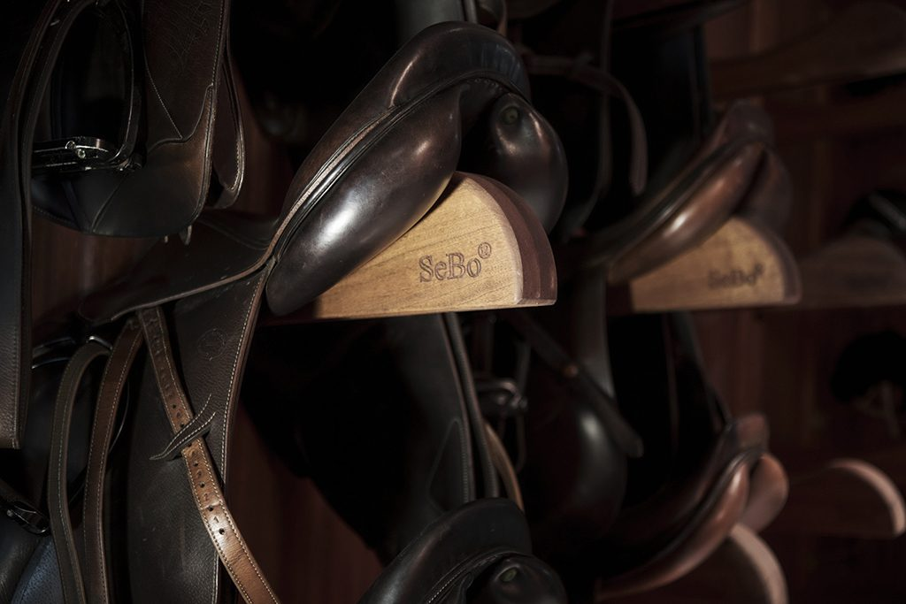 Tack room with saddle supports in detail