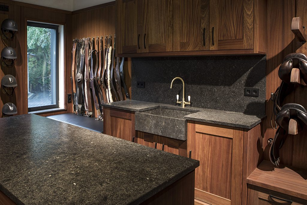 Tack room black with Mahogany, stone worktop and sink