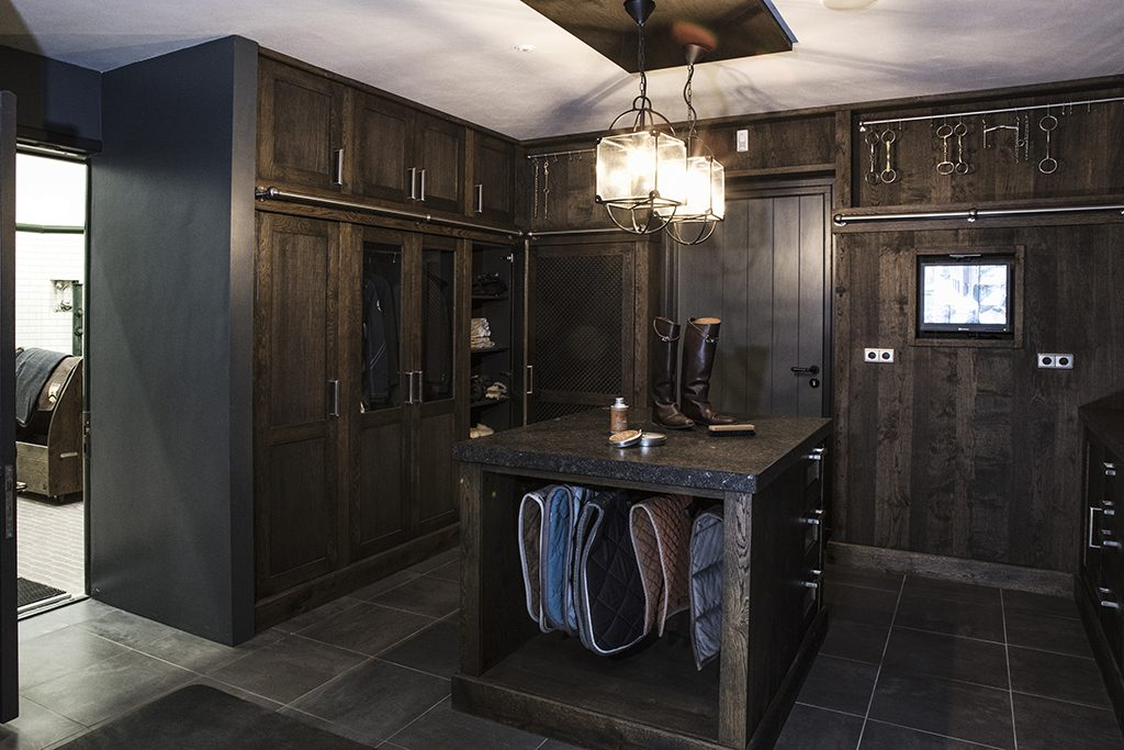 tack room with work island and wardrobe