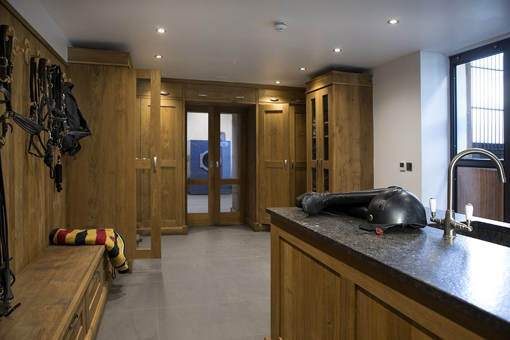 tack room with sliding doors adjoining the stable