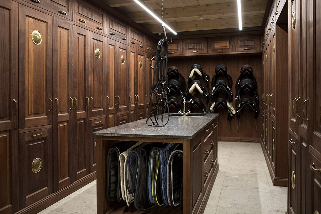 luxury tack room interior with custom hanging system