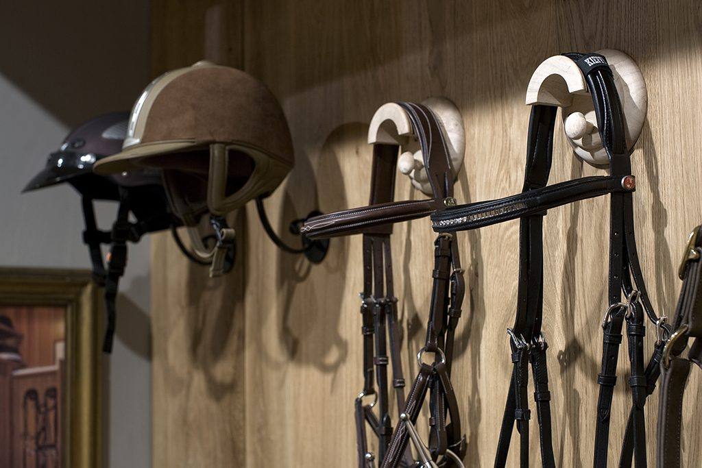 Tack room natural oak with SeBo accessories; Bridle and cap holders