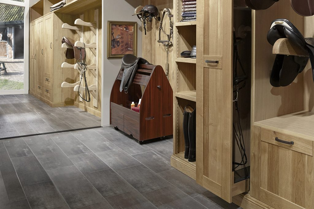 Mobile mahogany saddle car in oak tack room